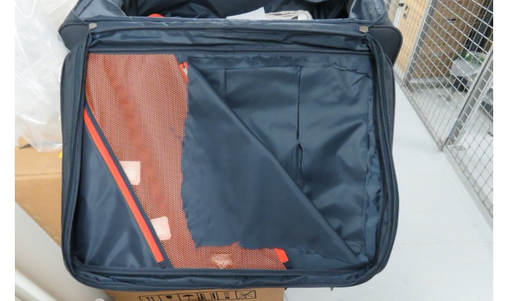 Suitcase with hidden compartment