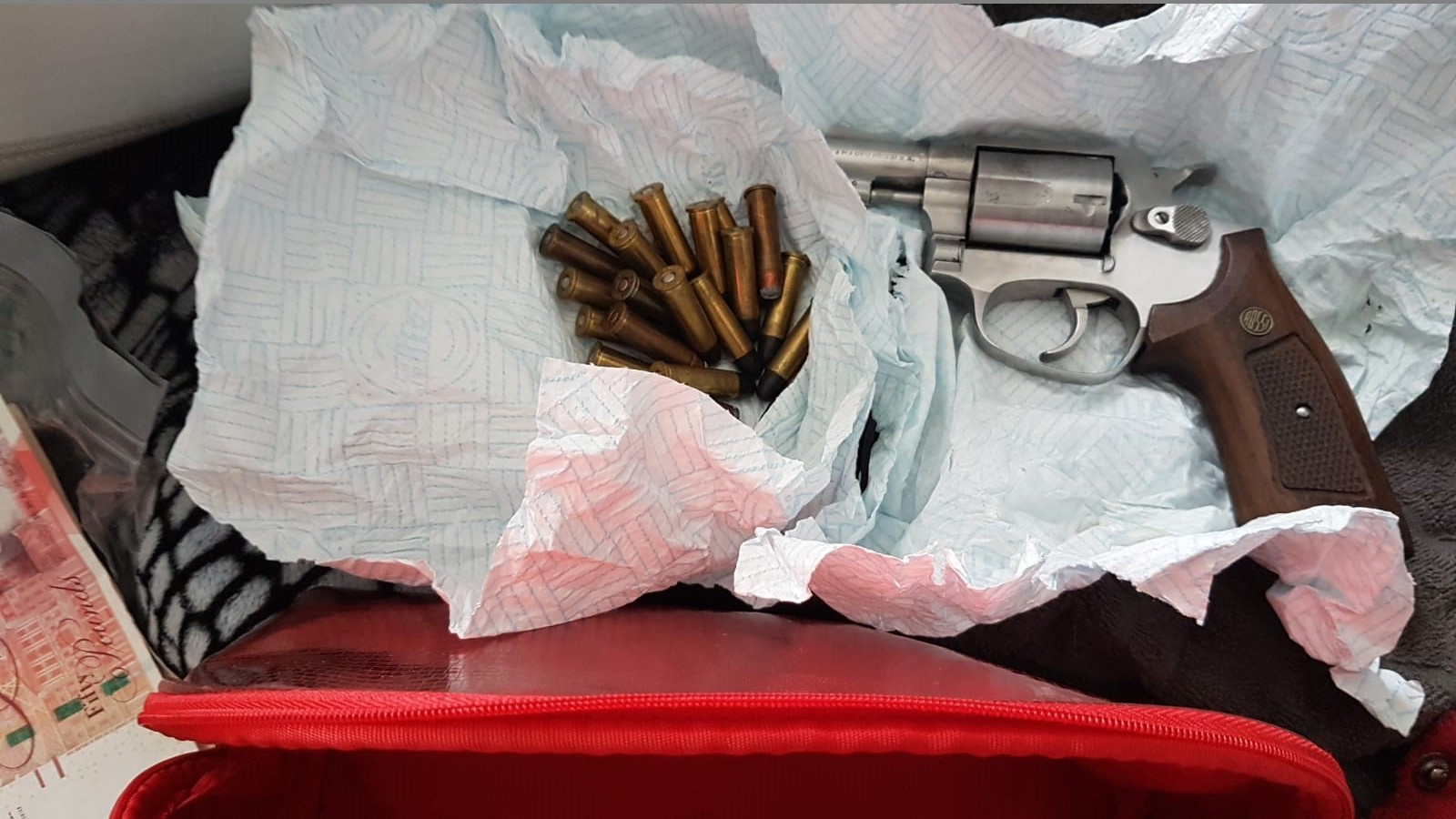 Picture of handgun and bullets