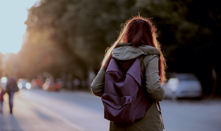 Teenager holding backpack