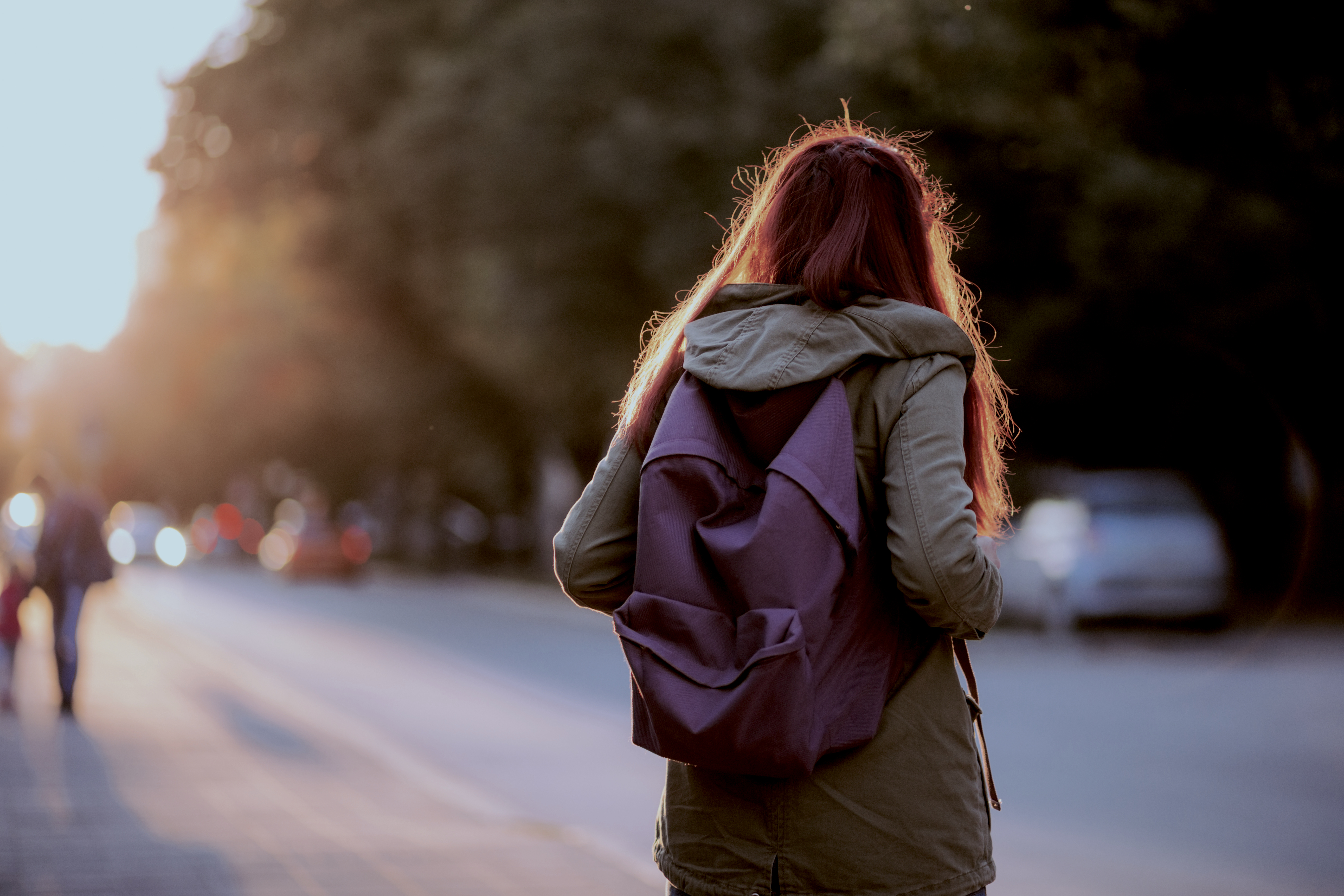 Teenager holding backpack