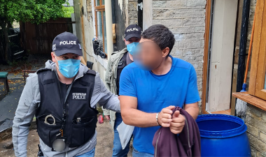 Image showing individual being arrested.