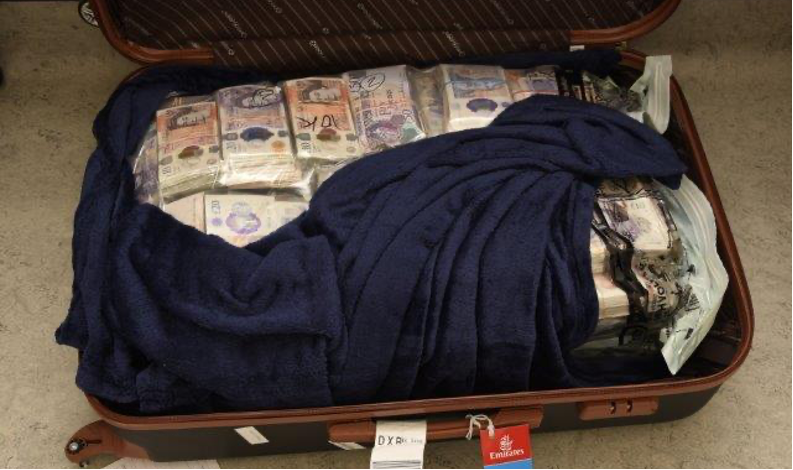 Money launderer tried to leave Heathrow with suitcases stuffed full of cash