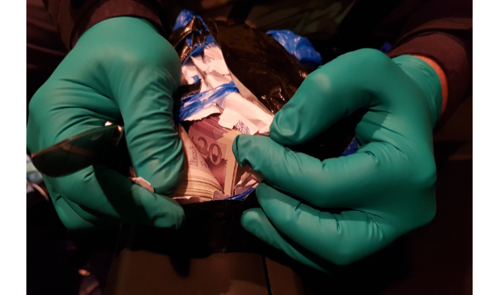 Two men charged in cash find at the border