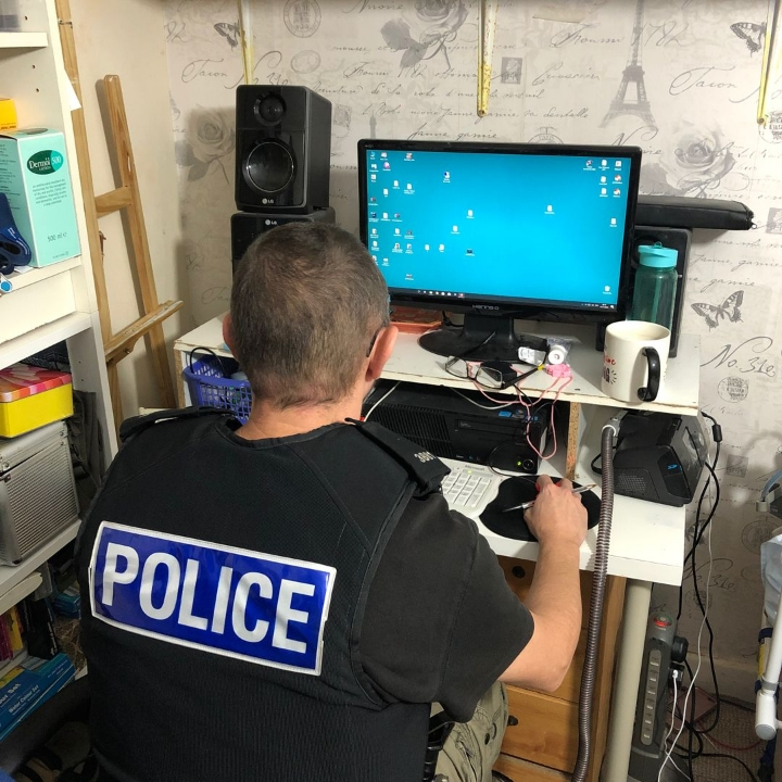 Police officer on computer