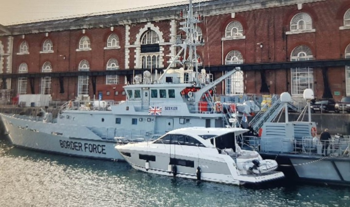 Yacht and border force cutter